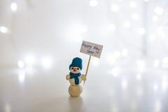 Schneemann, guten Rutsch ins Neue Jahr 2016, weißer Hintergrund, helle Girlande Lizenzfreies Stockfoto