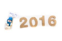 Schneemann, guten Rutsch ins Neue Jahr 2016, weißer Hintergrund, helle Girlande Stockfotografie