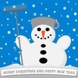 Schneemann mit einem Besen und einem Topf auf seinem Kopf Stockbild