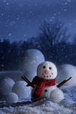 Schneemann mit winterlichem Hintergrund Stockbilder