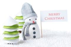 Schneemann mit Zeichen der frohen Weihnachten stockfotos