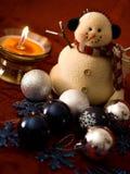 Schneemann und Kerze Stockbild