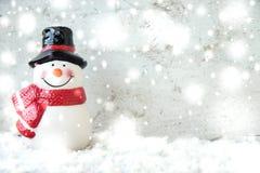 Schneemann und Schneefälle Stockfoto