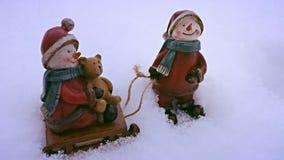 Schneemannspielen Stockfotografie
