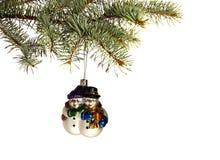 Schneemannspielzeug auf Weihnachtsbaum Stockfotografie