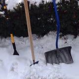 Schneeschaufeln Stockbild