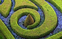 Schneiden Sie Büsche und Blumen Stockbild
