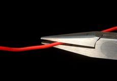 Schneiden Sie den roten Seilzug!! Lizenzfreies Stockfoto