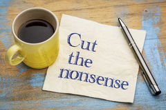 Schneiden Sie den Unsinn - Serviettenhandschrift stockbild