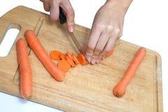 Schneiden Sie die Karotten Stockfotos