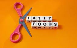 Schneiden Sie fetthaltige Nahrungsmittel heraus Lizenzfreies Stockfoto