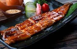 Schneiden Sie gegrillten japanischen Aal Stockbild