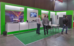 Schneider Electric company booth at CEE 2015, the largest electronics trade show in Ukraine. People visit Schneider Electric, France electronics manufacturer Royalty Free Stock Photography