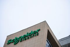 Schneider Electric logo in front of their main office for Serbia. Schneider Electric is a French group specialized in Engineering. Picture of a sign with the stock images
