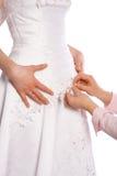 Schneider nähen Kleid der Braut Lizenzfreies Stockfoto