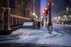 Schneien auf Wall Street Stockbilder