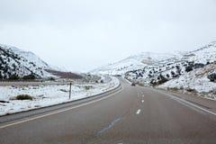 Schneiende I 15 zwischenstaatliche geschneite Straße US in Nevada Stockbild