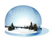 Schnekugel mit einer Weihnachtslandschaft Stockfotografie