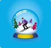 Schnekugel-Skifahrer Stockfotografie