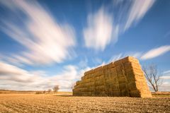 Fast moving clouds over rural region royalty free stock photos
