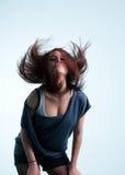 Schnelle Bewegungen des Mädchens ihr Haar Lizenzfreies Stockbild
