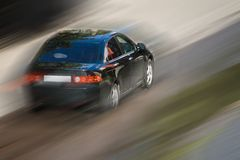 Schnellfahrenauto Stockfotografie