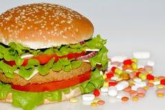 Schnellimbiß und Pillen Stockfoto