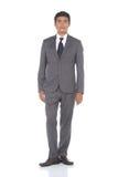 Schnellzahl in voller Länge, Geschäftsmann-Stand in Gray Suit keucht a Lizenzfreie Stockbilder