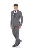 Schnellzahl in voller Länge, Geschäftsmann-Stand in Gray Suit keucht a Lizenzfreies Stockbild