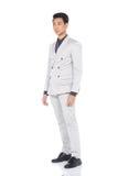 Schnellzahl in voller Länge, Geschäftsmann-Stand in Gray Suit keucht a Stockbilder