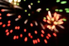 Schöner Feuerwerksunschärfehintergrund feiern herein Tagesisolat auf schwarzem Hintergrund Lizenzfreies Stockfoto