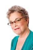 Schönes glückliches lächelndes älteres Frauengesicht Lizenzfreie Stockfotografie