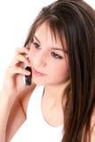 Schönes jugendlich Mädchen mit Mobiltelefon-hoher Taste Lizenzfreie Stockbilder