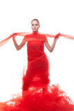 Schönes Mädchen in einem roten Tuch Lizenzfreies Stockfoto