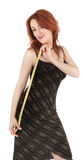 Schönes red-haired Mädchen mit Messinstrument in der Hand Stockbild