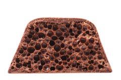 Schnitt der porösen Milchschokolade. Stockbild