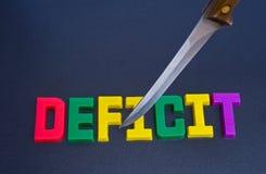 Schnitt des Defizits: Effekt der Rezession. Lizenzfreies Stockfoto