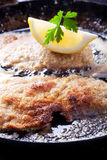Schnitzel. Wiener schnitzel frying in a pan Royalty Free Stock Images