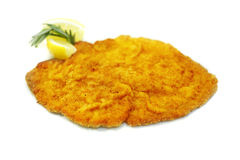 Schnitzel. Escalope meat with lemon and rosemary on white Royalty Free Stock Photos