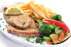 Schnitzel. With french fries and colorful vegetables.  Could be chicken, veal, or fish Stock Photos