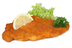 Schnitzel chop cutlet with lemon and lettuce isolated Royalty Free Stock Photos