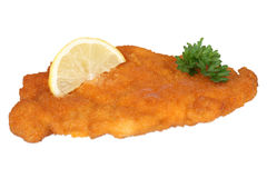 Schnitzel chop cutlet with lemon and parsley isolated Stock Photos