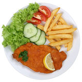 Schnitzel chop cutlet meal with french fries on plate isolated Royalty Free Stock Photos