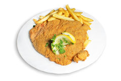 Schnitzel with french fries. Cutlet with french fries and lemon piece on isolated white background Royalty Free Stock Images