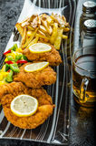 Schnitzel with french fries Royalty Free Stock Image