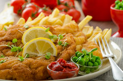 Schnitzel, french fries and microgreens salad Royalty Free Stock Photos