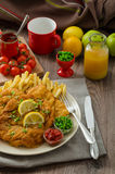 Schnitzel, french fries and microgreens salad Stock Images