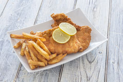 Schnitzel and French Fries on a Plate stock photos