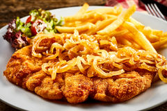 Schnitzel with fried onion stock image