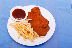 Schnitzel with fries Royalty Free Stock Photography